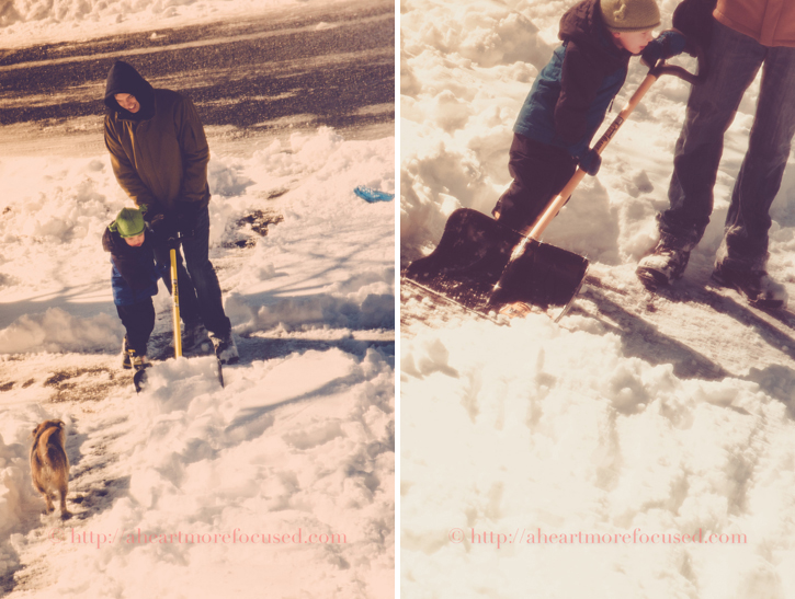 father son shoveling